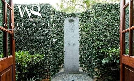 White River Manor: country Bathroom by Principia Design