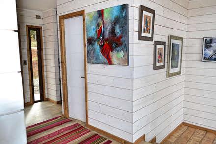 Casa Vichuquén: Paredes y pisos de estilo moderno por AtelierStudio