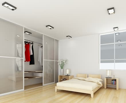 sliding wardrobes: modern Bedroom by Bravo London Ltd