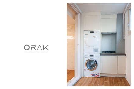도곡동 롯데캐슬모닝아파트 / 52평형 아파트 인테리어: 오락디자인의  베란다