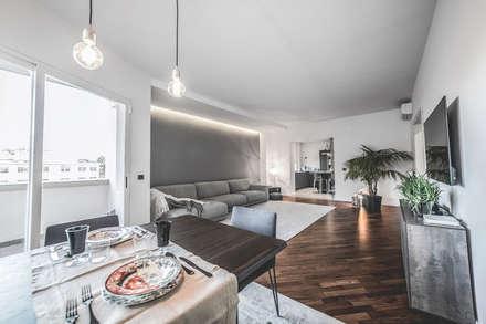 Terra Rossa House: Soggiorno in stile in stile Minimalista di MODO Architettura