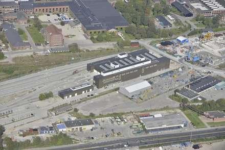 """""""Cityringen"""" - CMC: Garage/Rimessa in stile in stile Industriale di Studio Associato di architettura MBiM"""