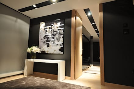 : Pasillos y vestíbulos de estilo  de Estudio Arinni S.L.