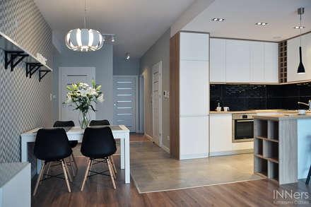 scandinavian Dining room by INNers - architektura wnętrza