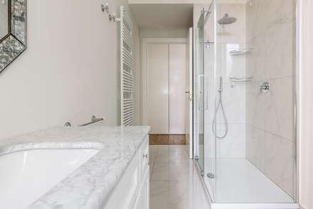 VIALE ABRUZZI: Bagno in stile in stile classico di NOMADE ARCHITETTURA E INTERIOR DESIGN
