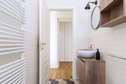 industrial Bathroom by NOMADE ARCHITETTURA E INTERIOR DESIGN