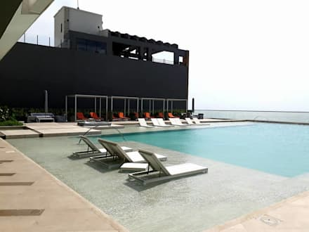 Jardines Edificio Morros City / Cartagena: Piscinas de estilo tropical por ecoexteriores