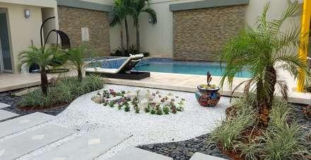 Casa residencial jardines / Barranquilla - ATL: Jardines de estilo tropical por ecoexteriores