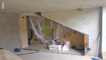 Abbattimento parete garage: Garage/Rimessa in stile in stile Moderno di ENRICO MARCHIARO _ eMsign Studio _ Architettura_Interior Design