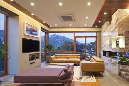 1층 거실: 건축사사무소 모도건축의  거실