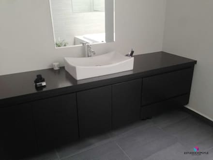 Casa 102: Baños de estilo  por Estudio Chipotle