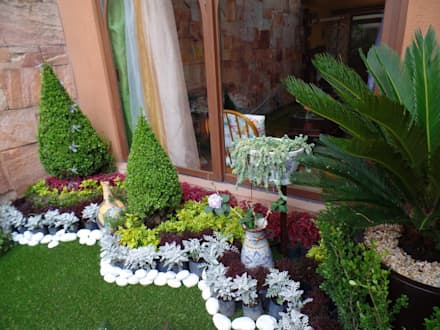 Jardines ideas im genes y decoraci n homify for Decoracion de jardines con jarrones de barro