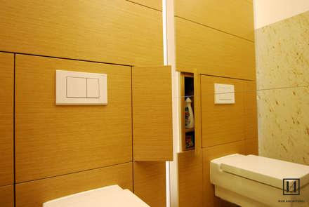 Toaleta dla gości w domu jednorodzinnym / Łańcut : styl , w kategorii Łazienka zaprojektowany przez Huk Architekci