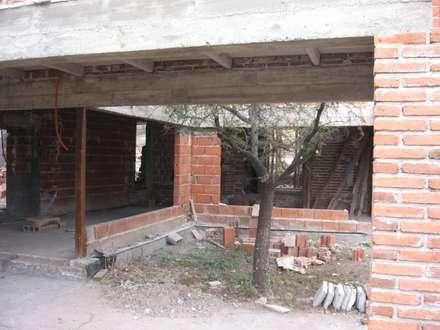 Casa MH: Jardines de invierno de estilo mediterraneo por Development Architectural group