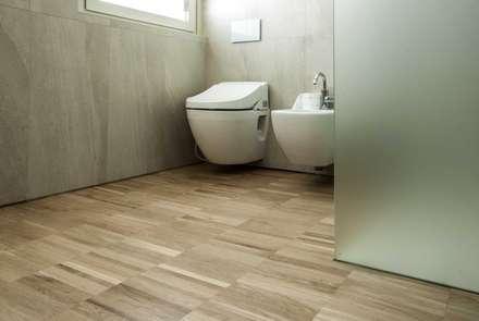 rock house di estudoquarto studio di architettura a verona: Bagno in stile in stile Minimalista di estudoquarto