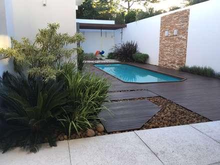 Residência Bagé/RS: Jardins modernos por Filhas do Ar