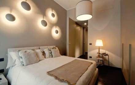 Camera da letto idee immagini e decorazione homify - Parete camera da letto tortora ...