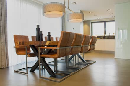 Cementgebonden gietvloer in moderne woning: moderne Eetkamer door Motion Gietvloeren