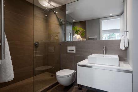 WATERFRON STAY_GULMARN APARTMENTS: scandinavian Bathroom by MINC DESIGN STUDIO
