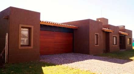 Casas de estilo  por Abitar arquitectura