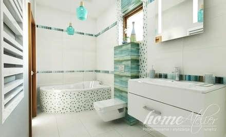 Baños de estilo colonial por Home Atelier