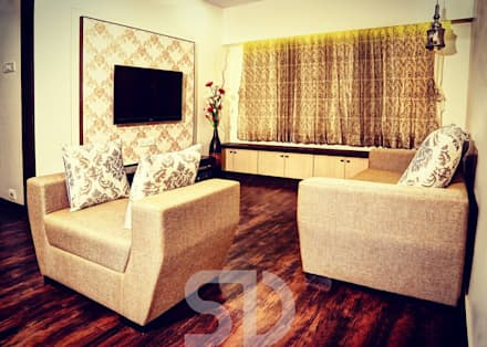T.V. Unit and Formal Sofa Seating arrangement: minimalistic Living room by SUMEDHRUVI DESIGN STUDIO