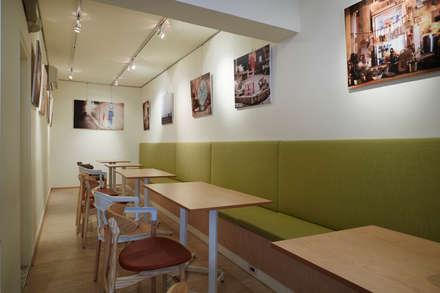 連貫的大地綠色延伸視覺入內也增添空間的一抹清爽:  餐廳 by 弘悅國際室內裝修有限公司