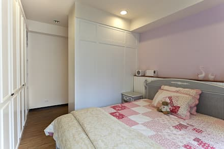 紫羅蘭夢幻色調搭配白色造型增添浪漫氛圍:  臥室 by 弘悅國際室內裝修有限公司