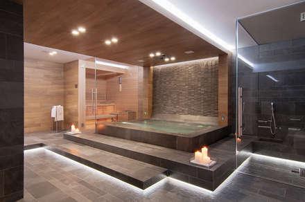 Spa de estilo moderno por STIMAMIGLIO conceptluxurydesign