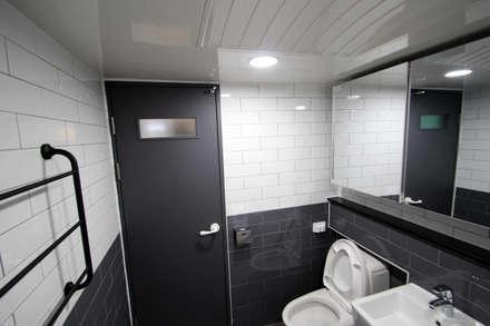 천안 백석동 호반 아파트 인테리어: STORY ON INTERIOR의  화장실