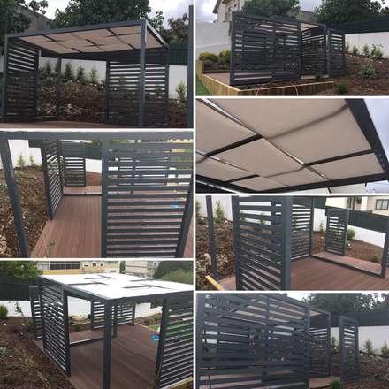 Projecto implementado moradia em Loures: Jardins modernos por CatarinaGDesigns
