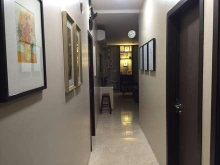 Private Reisdence - 3bhk apartment:  Corridor & hallway by One sq. meter Architects & Interior Designers