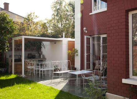 Casa Del Inca: Jardines de estilo moderno por RENOarq