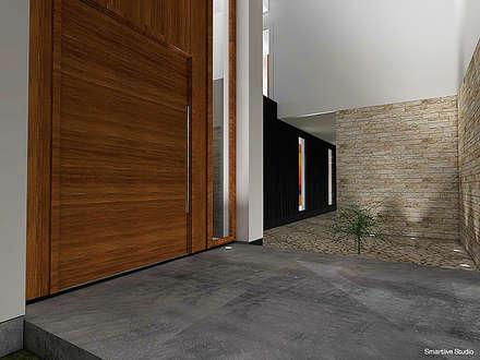 Casa Bravo - García, Ovalle, Chile: Pasillos, hall y escaleras de estilo  por Smartlive Studio