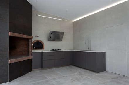 : Cozinhas modernas por Raul Garcia Studio