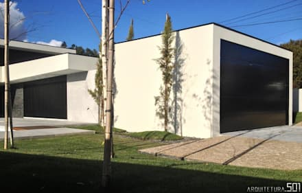 casa JL: Garagens e arrecadações minimalistas por arquitetura.501