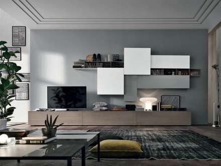 La zona giorno: Soggiorno in stile in stile Moderno di Abita design srl / Paolo Vindigni