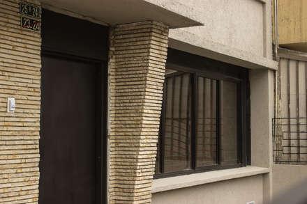 : Edificios de oficinas de estilo  por Ensamble de Arquitectura Integral
