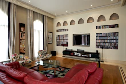 built it wall shelving custom for precise living: mediterranean Media room by Design Zone