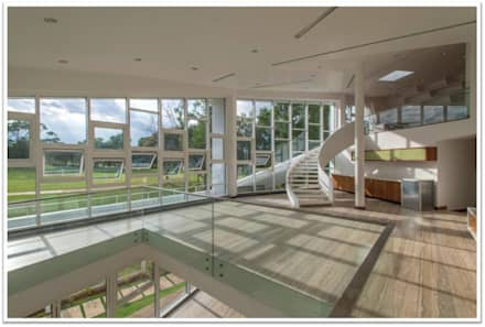 Living, Staircase, Library:  Corridor & hallway by Vivek Shankar Architects