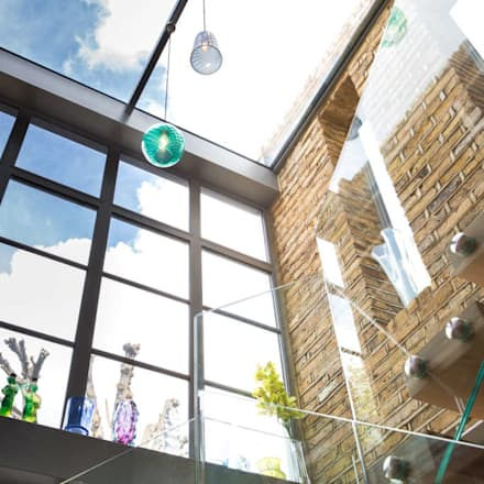 Double height crittall style extension:  Corridor & hallway by HollandGreen