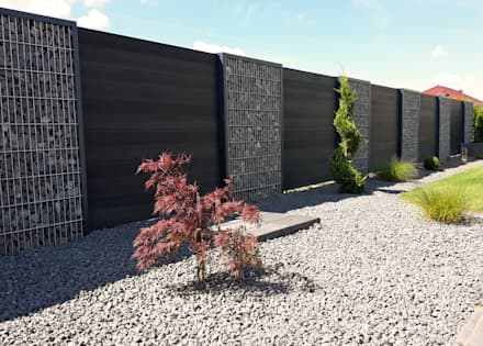 Gabionen-Zaunanlage mit Sichtschutzelementen aus WPC:  Vorgarten von Steelmanufaktur Beyer