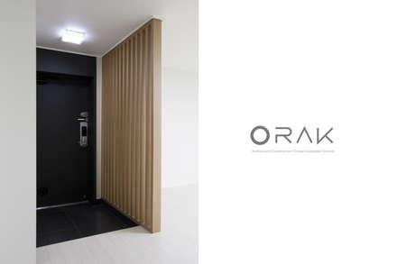정자동 임광보성아파트 / 33평형 아파트 인테리어: 오락디자인의  복도 & 현관