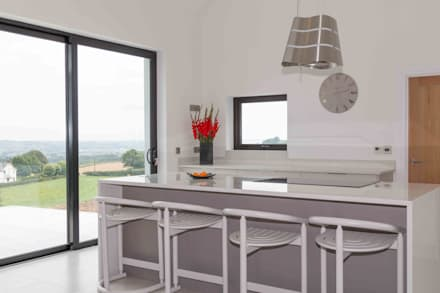 Countryside Views are appreciated from the large seating area on the island:  Built-in kitchens by ADORNAS KITCHENS