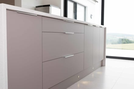 Modern basalt doors with streamlined handles create a german look:  Built-in kitchens by ADORNAS KITCHENS