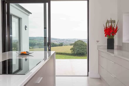 Views of the rolling countryside were the home owners incentive to buy this plot:  Built-in kitchens by ADORNAS KITCHENS