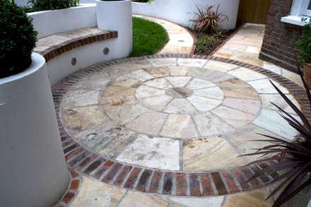 Sandstone circle: mediterranean Garden by Earth Designs