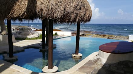 Piscinas infinitas de estilo  por DHI Arquitectos y Constructores de la Riviera Maya