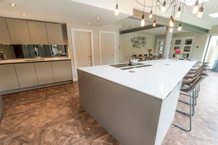 Kitchen Island reflects the shape of the extension:  Built-in kitchens by John Gauld Photography