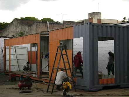 Proceso de pintura: Casas prefabricadas de estilo  por Home Box Arquitectura
